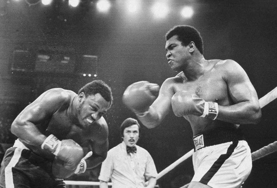 Joe Frazier (left) and Muhammad Ali are two of the three box-ing champs Richard Hoffer writes about.